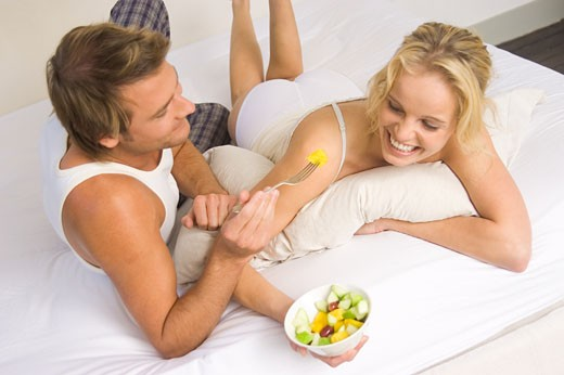 Couple having breakfast in bed : Stock Photo