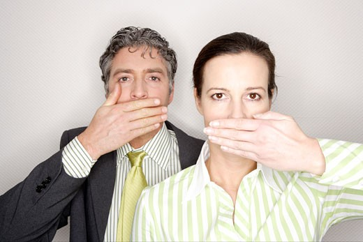 Businesspeople covering their mouths : Stock Photo