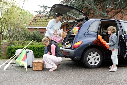 Family packing car : Stock Photo