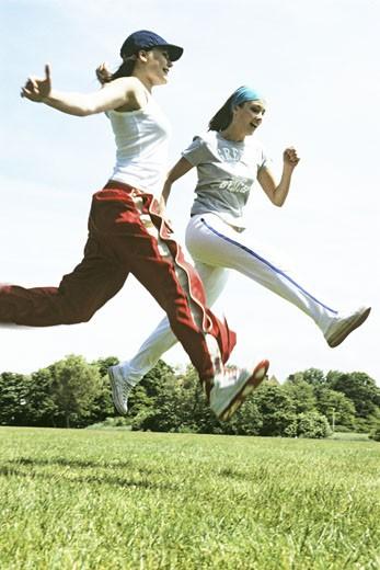 Women jumping : Stock Photo