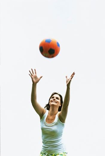 Woman catching ball : Stock Photo