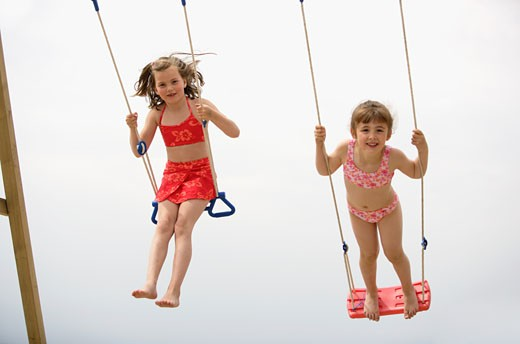 Stock Photo: 1779R-8649 Young girls swinging