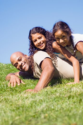 Stock Photo: 1779R-8831 Father and daughters smiling