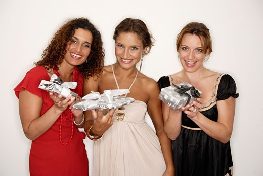 Stock Photo: 1779R-8990 Women holding Christmas gifts