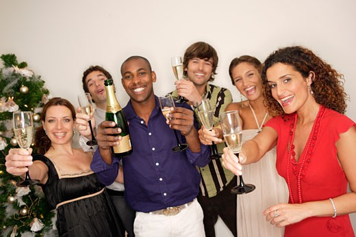 Friends toasting each other with champagne : Stock Photo