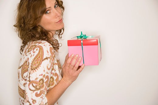 Stock Photo: 1779R-9501 Woman holding gift