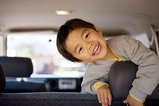 Boy in backseat of car : Stock Photo