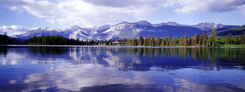 Rockies reflected in Lake Beauvert , Jasper National Park, Canada : Stock Photo