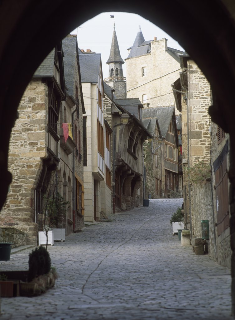 Cobblestone street under archway at Dinan Rue Du Jerzual, Brittany, France. : Stock Photo