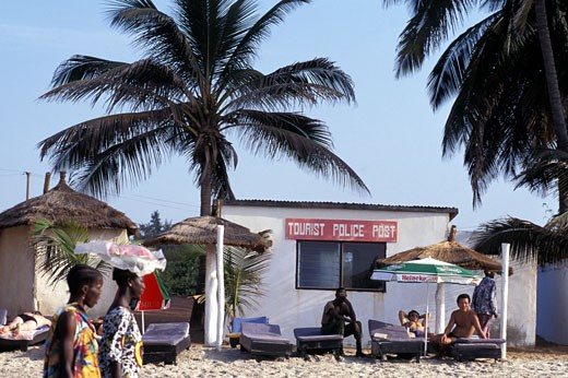 Sunbathers infront of Tourist Police Post , Gambia. : Stock Photo