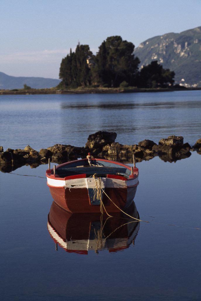 Stock Photo: 1783-13248 Single boat on estuary, Pondikonissi, Mouse Island, Corfu, Greece.