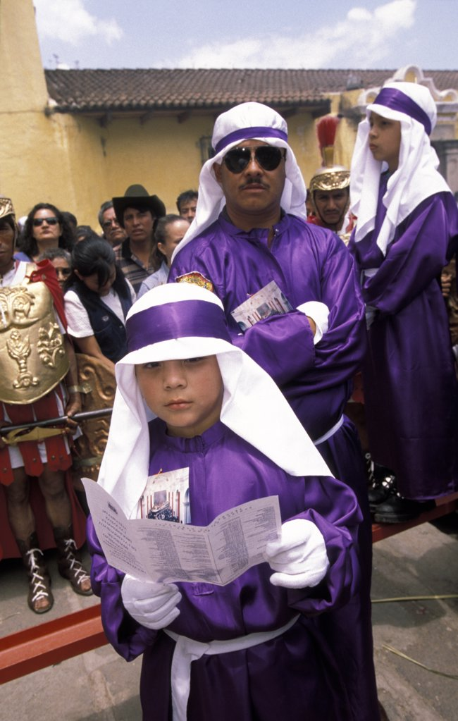 Stock Photo: 1783-13542 Man and boy dressed in purple robes, Semana Santa, Huehuetenango  , Antigua, Guatemala.