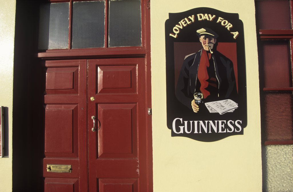 Stock Photo: 1783-15036 Guinness ad on wall of The Capitol Bar pub, Cashel, County Tipperary, Ireland.
