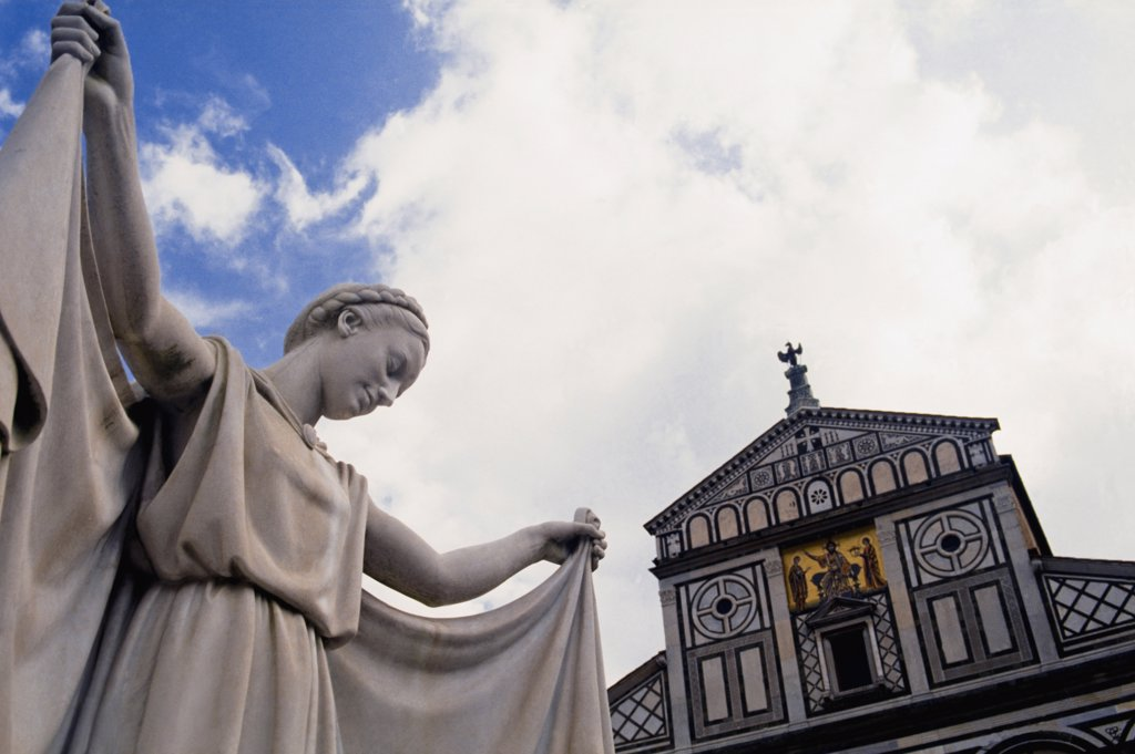Stock Photo: 1783-15755 Basilica di San Miniato al Monte and statue, low angle view, Florence, Tuscany, Italy