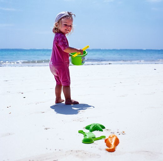 Stock Photo: 1783-16620 Child playing on beach with bucket and spade, Diani Beach, Mombasa Coast, Indian Ocean, Kenya