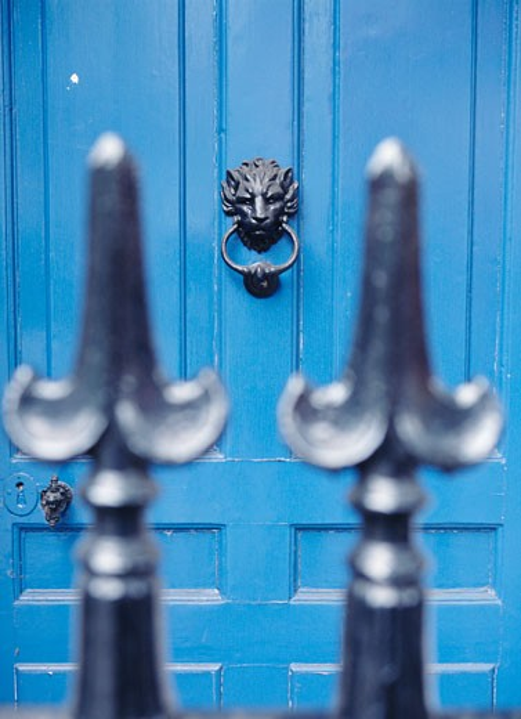 Blue door with lion door knocker as seen through iron fence, London, Westminster, London  : Stock Photo