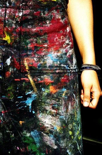 Stock Photo: 1783-17322 Paint splattered apron and arm, close up, London, England