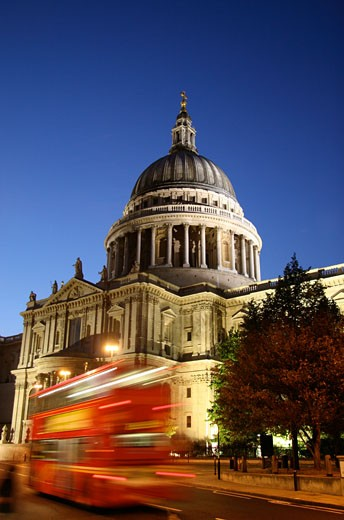 Red double decker bus passing St Paul's Cathedral, Blurred Motion, London, England : Stock Photo