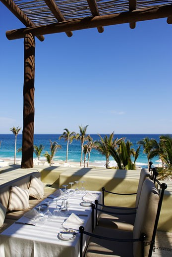 Stock Photo: 1783-18279 Dining tables by beach, Los Cabos, Mexico.