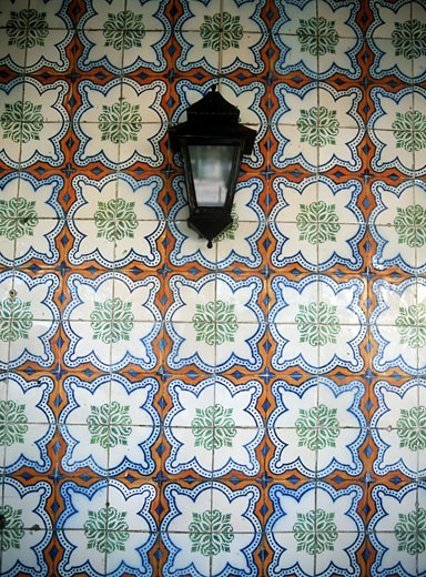 Lantern in front of wall covered with floral pattern, Sintra, Lisbon, Portugal. : Stock Photo
