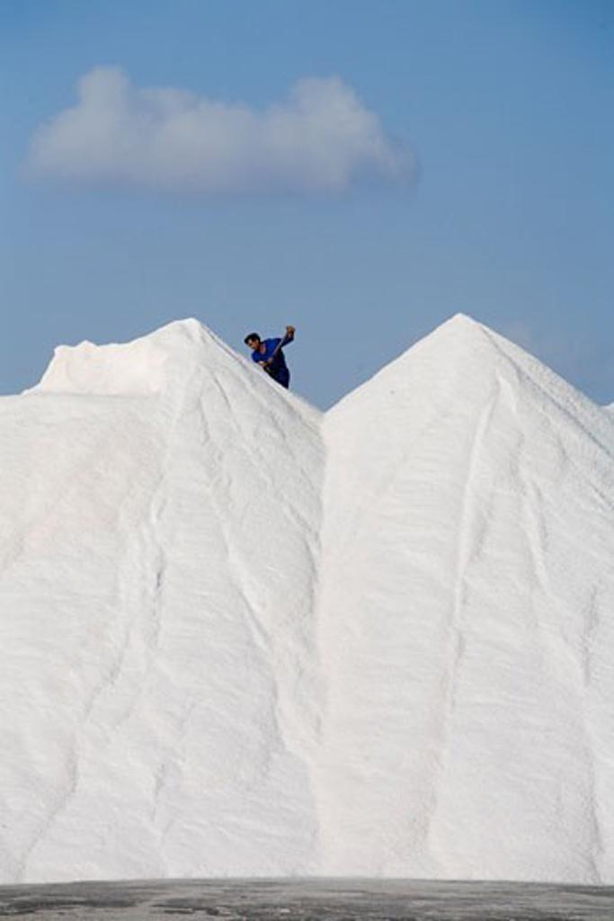 Stock Photo: 1783-19823 Man on top of salt heaps, Enveses Beach, Cabo De Gata Natural Park, Almeria, Spain.