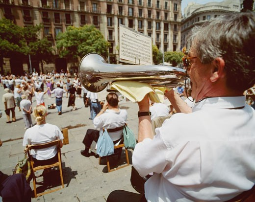 Man playing trumpet in front of Barcelona Cathedral, Gothic quarter, Barcelona, Spain. : Stock Photo