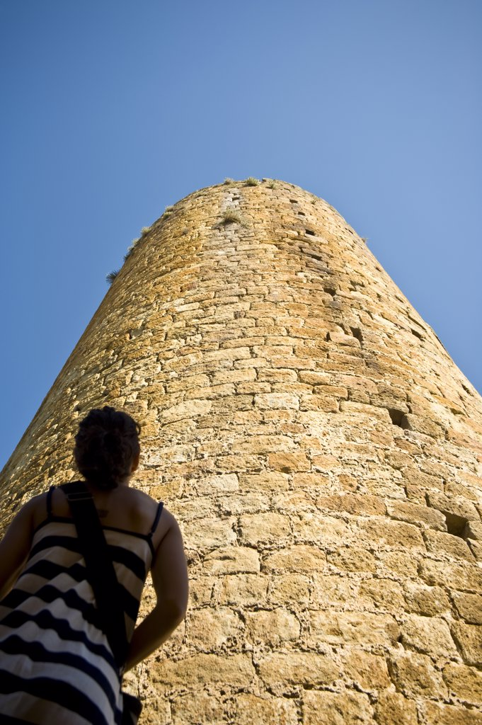 Girl looking at castle tower in medieval village, Pals, Costa Brava, Catalunya, Spain. : Stock Photo