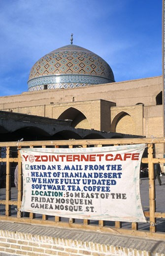 Stock Photo: 1783-2054 Sign for internet cafe in front of mosque dome, old vs. new, Jama Mosque, Yazd, Iran.