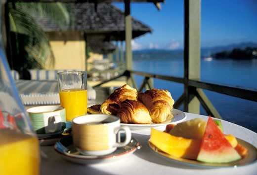Stock Photo: 1783-21416 Breakfast of fruit and croissants by the sea , Vanuatu