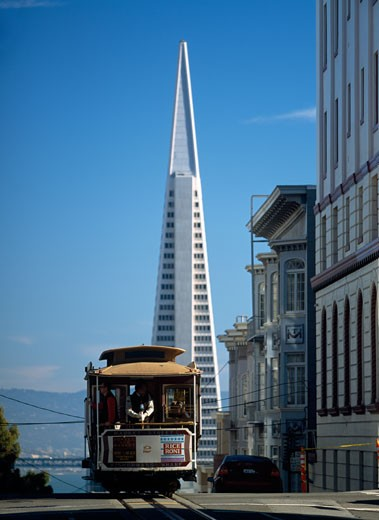 Stock Photo: 1783-23874 Cable car going down Washington Street on Nob Hill with the Trans-America Pyramid behind, San Francisco, California