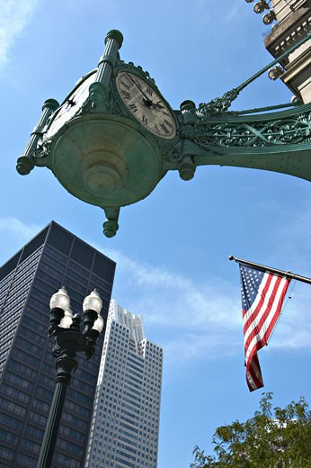 Stock Photo: 1783-24025 Corner clock outside of Marshall Field and Company Building, Chicago, Illinois, USA.