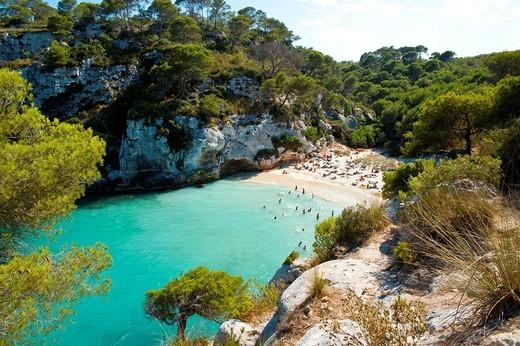 Tourists at Cala MacarelletaMenorca, Balearic Islands, Spain. Tourists at Cala Macarelleta : Stock Photo