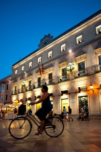 Stock Photo: 1783-31283 Cyclists In Placa De La Catedral In Ciutadella At Night, Menorca, Balearic Islands, Spain. Cyclists In Placa De La Catedral In Ciutadella At Night