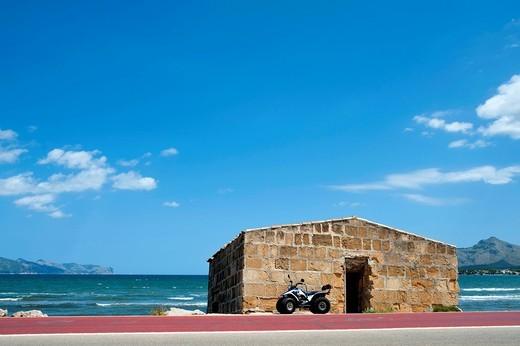Motorbike parked in S´albufereta near AlcudiaMallorca, Balearic Islands, Spain. Motorbike parked in S´albufereta near Alcudia : Stock Photo