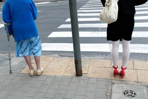 Two women of different generations about to cross a street in WarsawWarsaw, Poland. Two women of different generations about to cross a street in Warsaw : Stock Photo