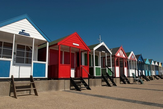 Stock Photo: 1783-31355 Traditional beach huts on the seafront at SouthwoldSouthwold, Suffolk, UK. Traditional beach huts on the seafront at Southwold