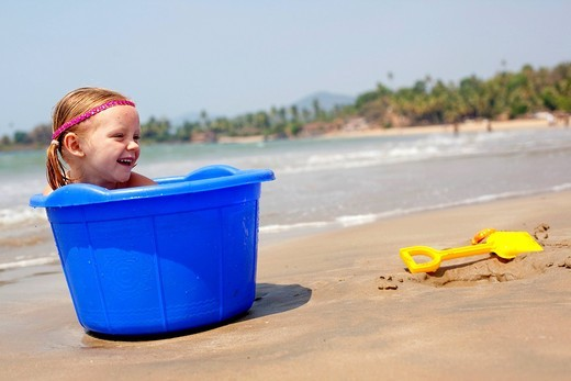 Girl plays with buckets and spades on Patnum beachPatnum beach, Goa, India. Girl plays with buckets and spades on Patnum beach : Stock Photo