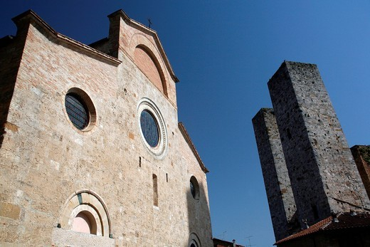 Church and two of the Towers of San GimignanoTuscany, Italy. Church and two of the Towers of San Gimignano : Stock Photo