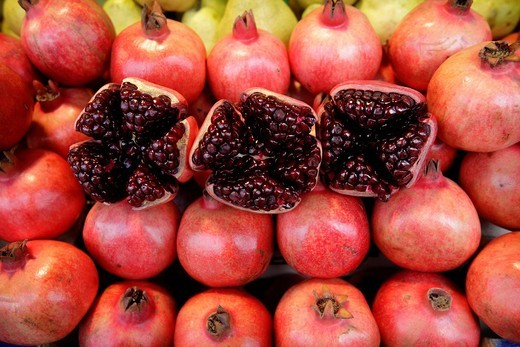 Pomegranate on display in the central market, close upRiga, Latvia. Pomegranate on display in the central market, close up : Stock Photo