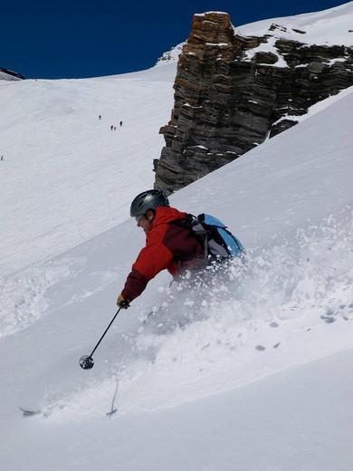 Solatary skier, off piste in fresh powder snow.Crans Montana, Valais, Switzerland. Solatary skier, off piste in fresh powder snow. : Stock Photo