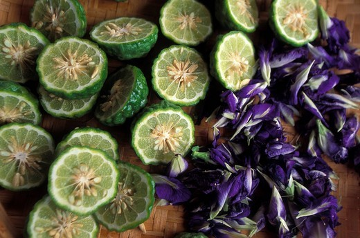 Stock Photo: 1783-31725 Fresh limes and flowers used in making a natural herbal shampooKhon Kaen, Thailand. Fresh limes and flowers used in making a natural herbal shampoo