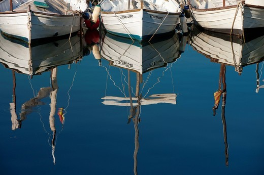 Reflections of small boats in the harbour of Port Soller Majorca, Spain. Reflections of small boats in the harbour of Port Soller : Stock Photo