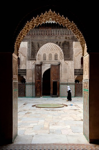 Woman walking through courtyard of Medersa Bou Inania, Fez, Morocco. Woman walking through courtyard of Medersa Bou Inania, : Stock Photo