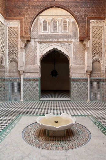 Courtyard and fountain of Medersa el Attarin Fez, Morocco. Courtyard and fountain of Medersa el Attarin : Stock Photo