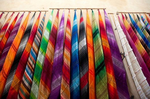 Colourful cloth for sale in alleyway in the souksFez, Morocco. Colourful cloth for sale in alleyway in the souks : Stock Photo