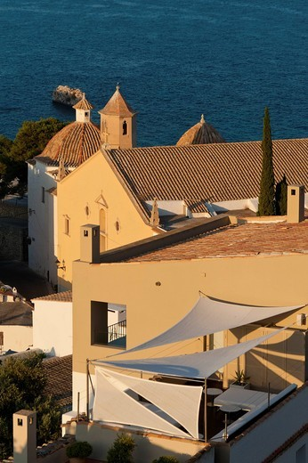Looking over shaded roof terrace and Santo Domingo church to seaDalt Vila, Ibiza Town, Ibiza, Spain. Looking over shaded roof terrace and Santo Domingo church to sea : Stock Photo