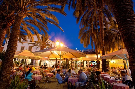 Stock Photo: 1783-31858 People In Bar / Cafe At Dusk, Ibiza Town, Ibiza, Spain. People In Bar / Cafe At Dusk