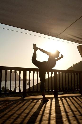 Lady doing yoga at Ibiza YogaBenirras, Ibiza, Spain. Lady doing yoga at Ibiza Yoga : Stock Photo