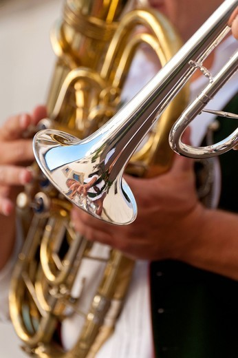 Detail of people playing trumpet and tubaOrtenburg, Bavaria, Germany. Detail of people playing trumpet and tuba : Stock Photo
