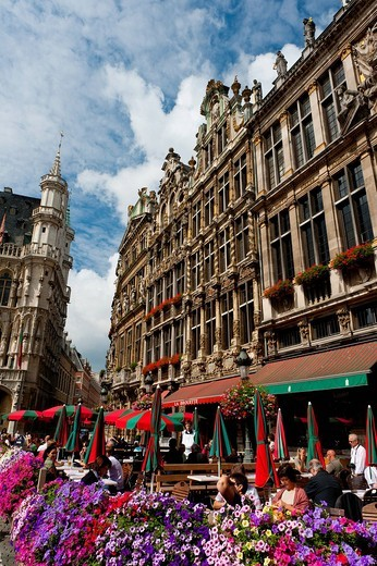 People Eating And Drinking Outside Cafes In The Grand Place, Grand Place, Brussels, Belgium. People Eating And Drinking Outside Cafes In The Grand Place : Stock Photo